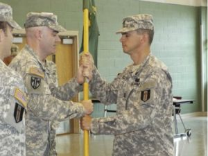 U.S. Army Reserve Capt. Eric Giles accepts the colors signifying his acceptance of the command of the 344th Military Police Company during a change of command ceremony June 22 at the Major General Maurice Rose Armed Forces Reserve Center in Middletown, Conn. Giles, a resident of Fishers Island, N.Y., comes to the 344th MP Company from his previous assignment with the 382nd Military Police Battalion at Westover Air Reserve Base, Mass., as the law and order operations officer.