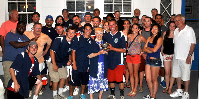 Following the annual Hay Harbor staff vs. Ferry crew softball game, Mrs. Kibbe presents the Kibbe Cup to the FI Ferry crew in 2013.